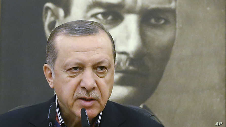 Turkey's President Recep Tayyip Erdogan, backdropped by a portrait of Turkish Republic founder Mustafa Kemal Ataturk, talks to members of the media in Istanbul, prior to his departure on a Mideast tour, Feb. 12, 2017.