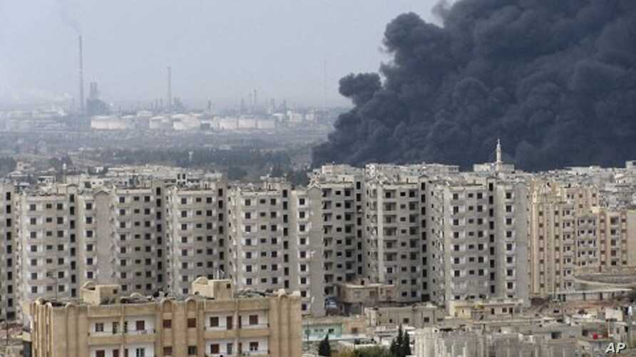 Black smoke is seen from Homs refinery, Syria, December 8, 2011.