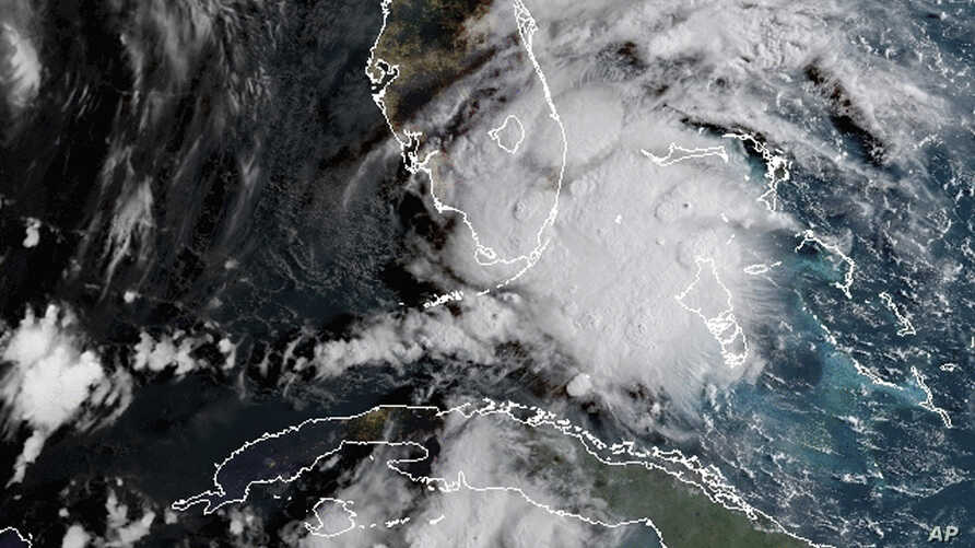 In this image released by NOAA's GOES-16 on Sept. 3, 2018, Tropical Storm Gordon appears south of Florida. The storm is expected to cross from southwest Florida into the Gulf Coast.