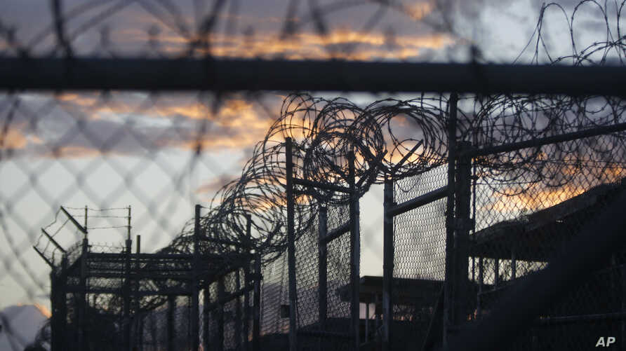 FILE - Dawn breaks at the now closed Camp X-Ray, used as the first detention facility for suspected militants captured after the Sept. 11 attacks, at the Guantanamo Bay Naval Base in Cuba, dawn arrives at the now closed Camp X-Ray, which was used as