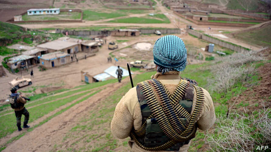 FILE - Afghan Nation Army (ANA) soldiers walk in formation during an operation in Bala Morghab district of Badghis province, March 26, 2017.