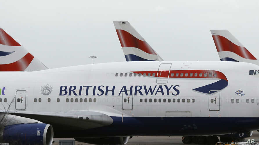 British Airways planes are parked at Heathrow Airport, Jan. 10, 2017. The airline cancelled flights from two major airports Saturday because, it said, of a power outage.
