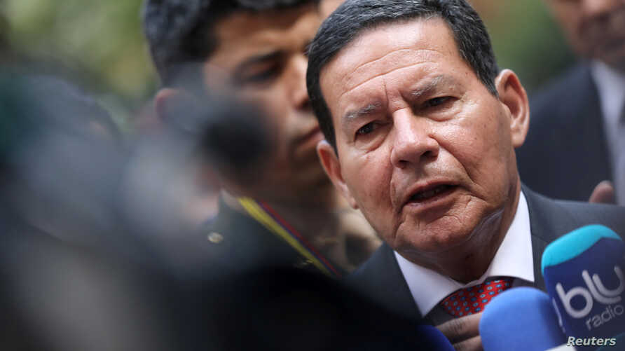 Brazil's Vice President Hamilton Mourao speaks to the media after a meeting of the Lima Group in Bogota, Colombia, Feb. 25, 2019.
