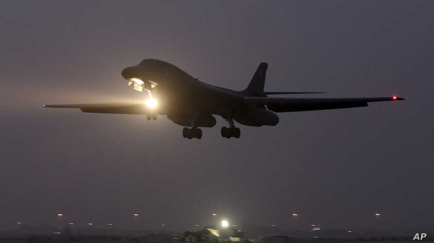FILE - A B-1 bomber prepares to land after finishing a mission at the al-Udeid Air Base in Doha, Qatar.