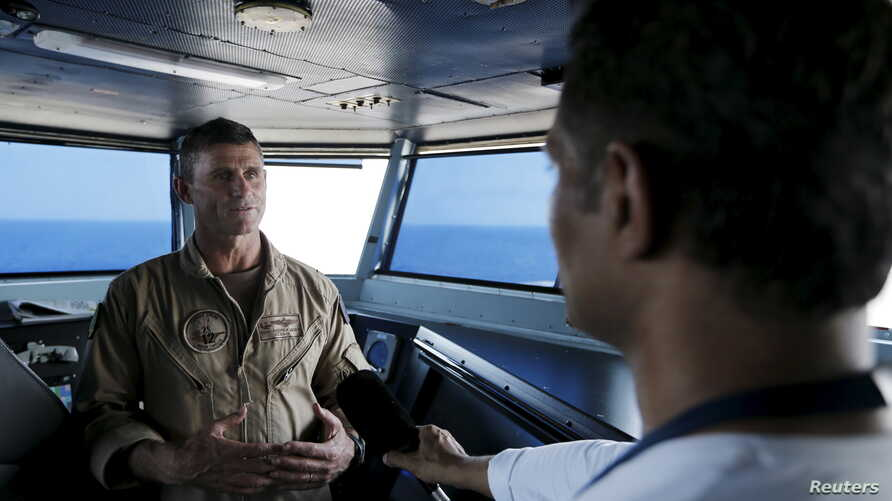 FILE - U.S. Navy Rear Admiral Andrew Lewis speaks during an interview on the bridge of the USS Theodore Roosevelt (CVN-71) aircraft carrier.