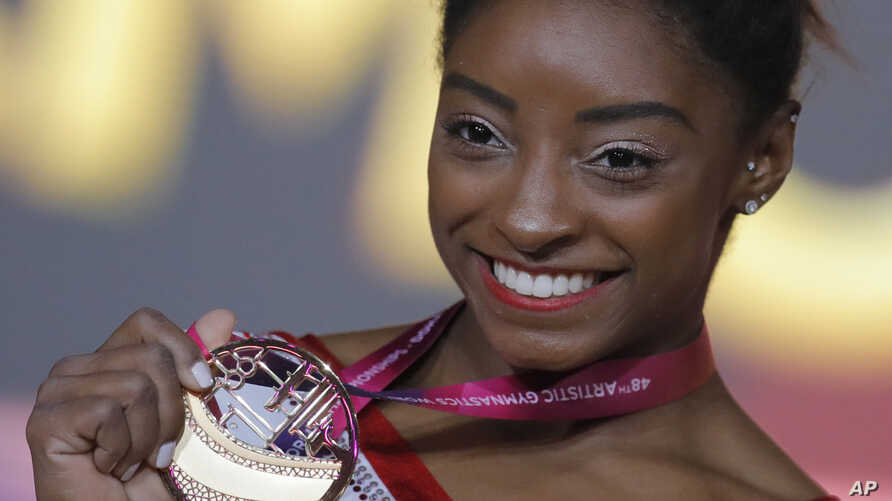 Simone Biles of the U.S. shows her gold medal after the women's vault final on the first day of the apparatus finals at the Gymnastics World Championships in Doha, Qatar, Nov. 2, 2018.