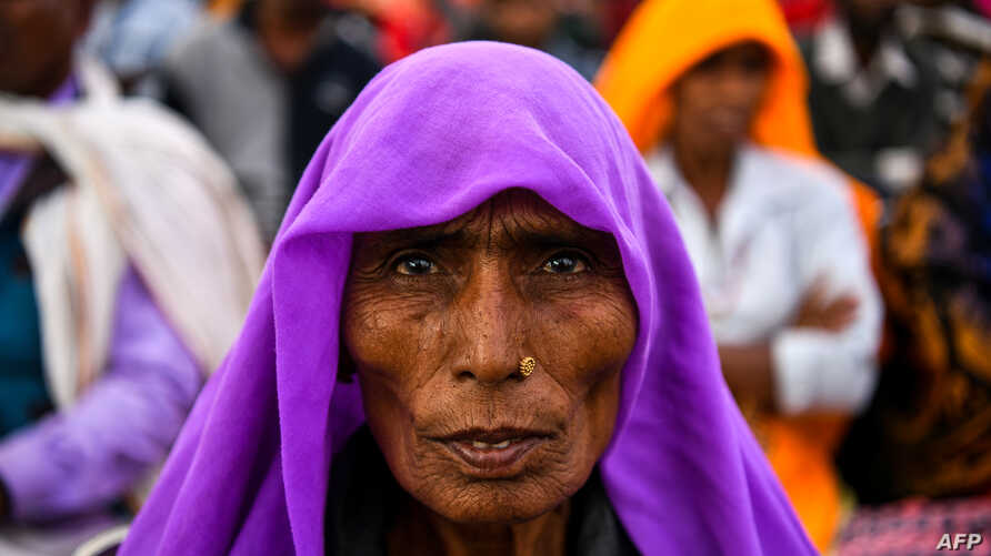 An Indian participant in the 'Dignity March' looks on as she attends the culmination of the march at Ramleela Ground in New Delhi on February 22, 2019.