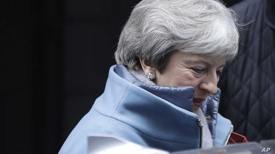 Britain's Prime Minister Theresa May leaves Downing Street to attend parliament in London, Jan. 21, 2019.