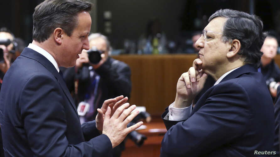 FILE - European Commission President Jose Manuel Barroso (R) and Britain's Prime Minister David Cameron are seen talking during a European Union leaders summit in Brussels.