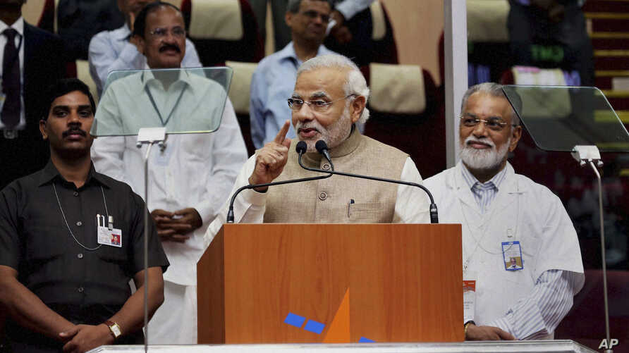 Indian Prime Minister Narendra Modi speaks after the successful launch of the Polar Satellite Launch Vehicle (PSLV-C23) in Sriharikota, India, June 30, 2014.
