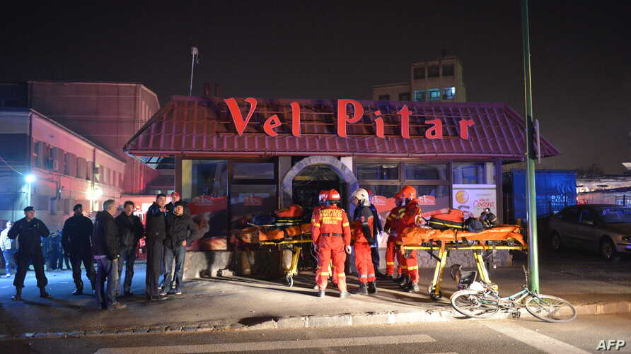 Members of the emergency services work outside a bread factory in Brasov, where an explosion occurred, injuring several people, Nov. 5, 2015.