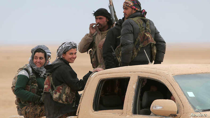 Syrian Democratic Forces fighters ride on a vehicle near Raqqa, Feb. 5, 2017. The U.S.-backed troops have made significant advances.