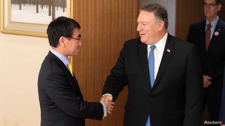 U.S. Secretary of State Mike Pompeo shakes hands with Japan's Foreign Minister Taro Kono before a meeting in Tokyo, Japan, Oct. 6, 2018.