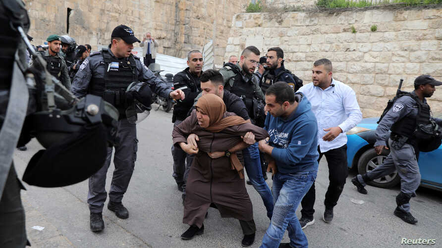 Israeli police officers scuffle with Palestinian protesters outside the Lions Gate to Jerusalem's Old City, March 12, 2019.