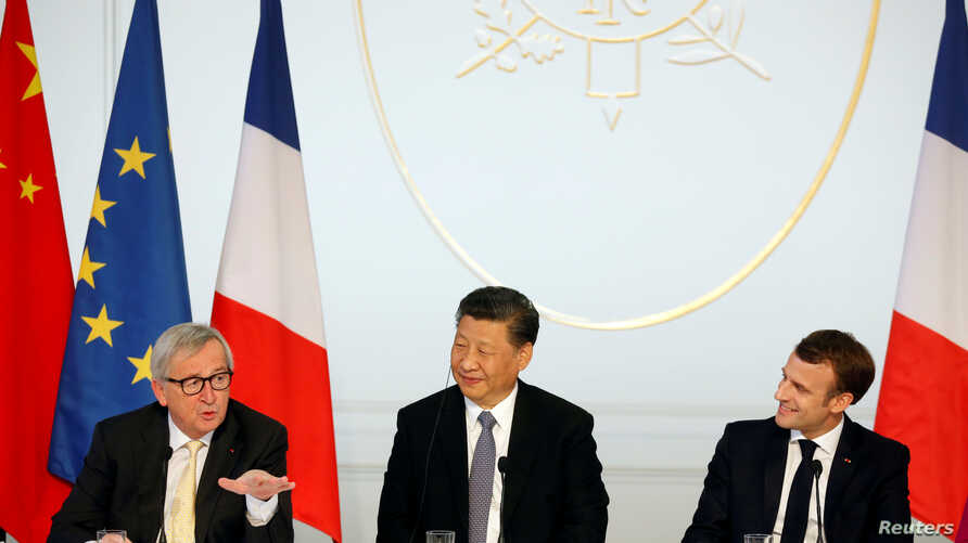 French President Emmanuel Macron, his Chinese counterpart Xi Jinping and European Commission President Jean-Claude Juncker hold a news conference with German Chancellor Angela Merkel at the Elysee presidential palace in Paris, France, March 26, 2019.