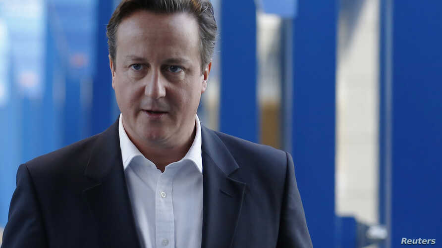 Britain's Prime Minister David Cameron returns to his hotel after giving radio interviews on the third day of the Conservative Party Conference in Birmingham, central England, Sept. 30, 2014.