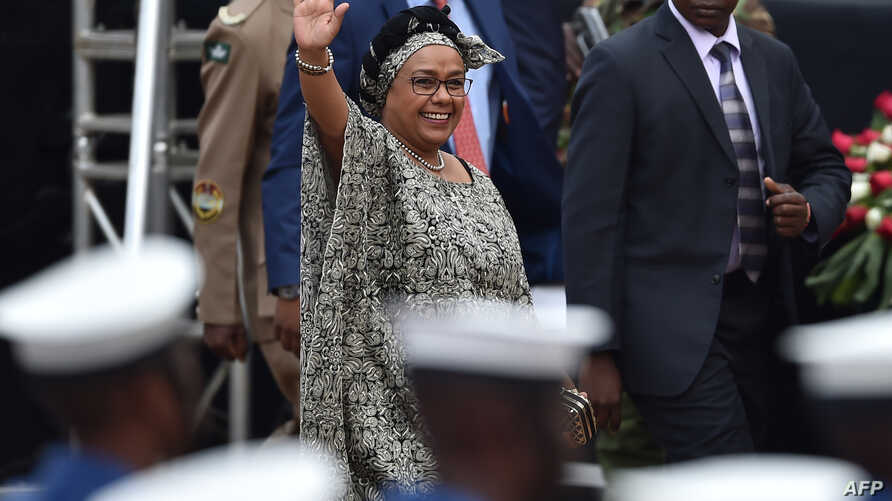 Kenya's first-lady, Margaret Kenyatta - wife of Kenya's President Uhuru Kenyatta - waves to supporters as she arrives in Nairobi on October 20, 2017, for commemorations of Mashujaa (Heroes) Day.