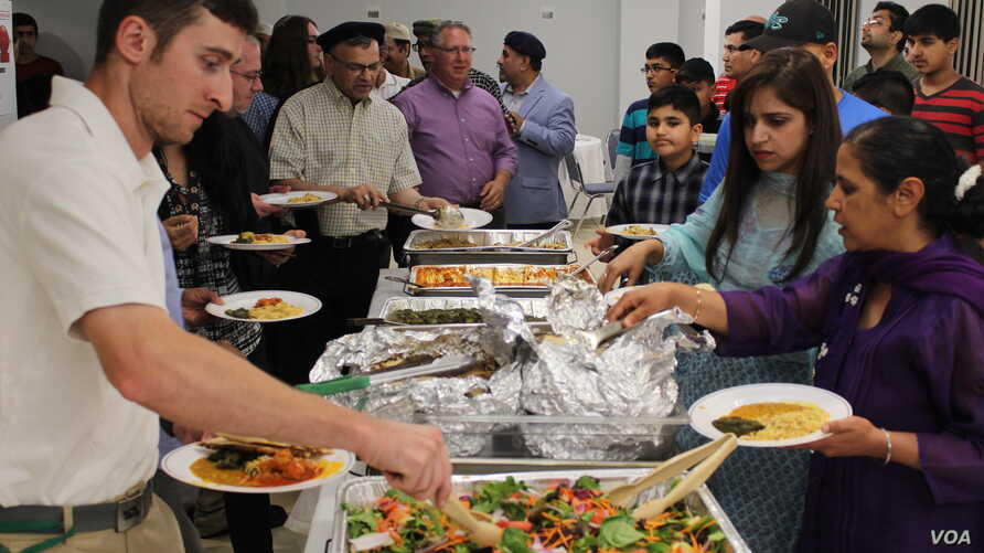 Muslims, Christians, Jews, Quakers, Buddhists, and Sikhs shared an iftar dinner during the holiest time in the Islamic calendar at the Bait-ur-Rehman Mosque in Silver Spring, Maryland, June 15, 2017. The meal consisted of traditional Pakistani dishes...