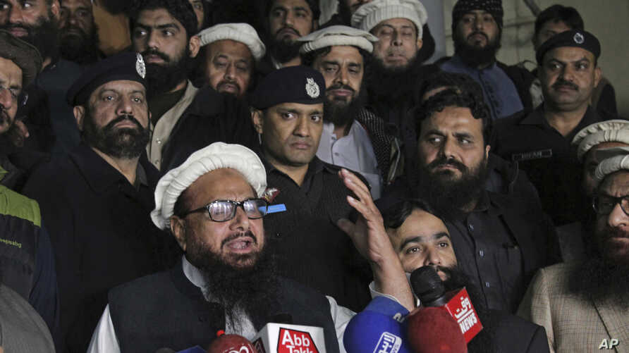 FILE - Hafiz Muhammad Saeed, leader of the Jamaat-ud-Dawa group, or JUD, addresses his supporters in Lahore, Pakistan, Jan. 30, 2017.