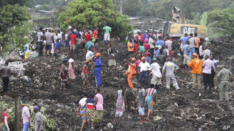Rescuers search for survivors at the collapse of a garbage mound in Maputo, Mozambique, Feb. 19, 2018.