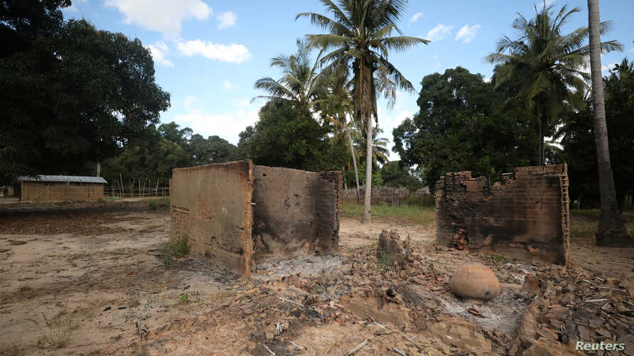 FILE - Burnt-out huts are seen at the scene of an armed attack in Chitolo village, Mozambique, July 10, 2018.