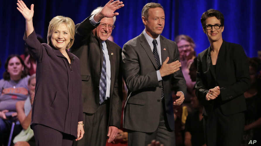 Democratic presidential candidates, from left, Hillary Clinton, Sen. Bernie Sanders and former Maryland Governor Martin O'Malley participate in a candidate forum hosted by MSNBC's Rachel Maddow, right, at Winthrop University in Rock Hill, S.C., Nov.