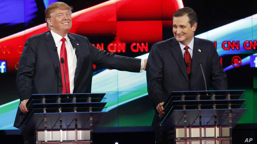 Donald Trump, left, jokes with Ted Cruz during the CNN Republican presidential debate at the Venetian Hotel & Casino on Tuesday, Dec. 15, 2015.