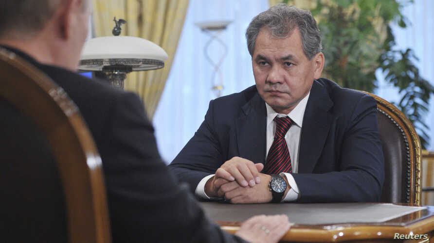 Former Governor of Moscow Region and newly appointed Defence Minister Sergei Shoigu meets with Russian President Vladimir Putin at the Novo-Ogaryovo state residence outside Moscow, November 6, 2012.