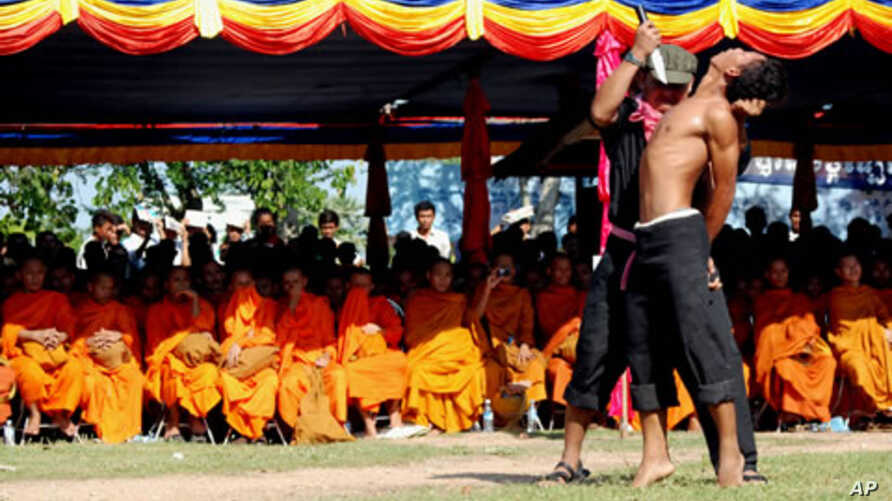 "Cambodian students re-enact torture executed by the Khmer Rouge to mark the annual ""Day of Anger"" at Choeung Ek, 20 May 2010"