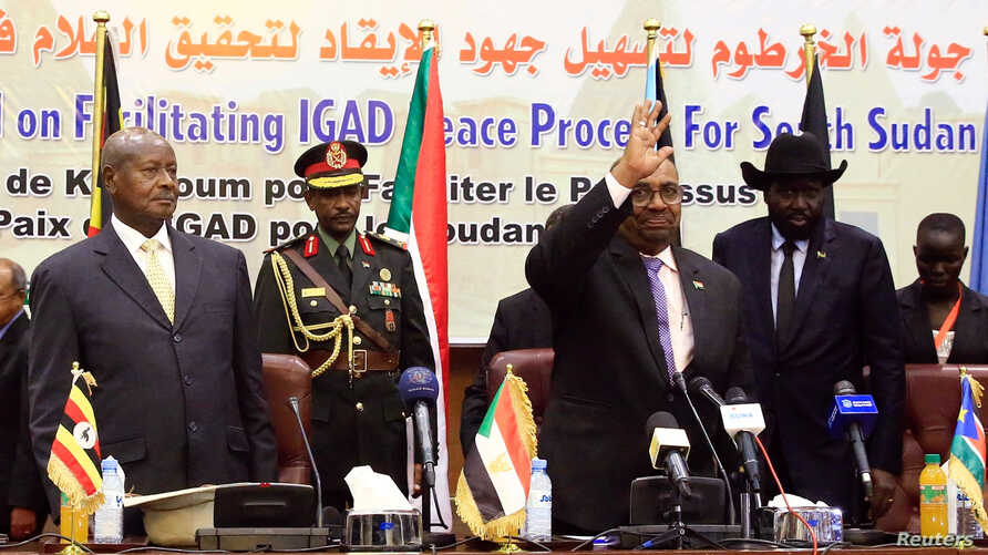Sudan's President Omar Al-Bashir flanked by Uganda's President Yoweri Museveni and South Sudan's President Salva Kiir welcomes delegates during a South Sudan peace meeting as part of talks to negotiate an end to a civil war, in Khartoum, Sudan, June