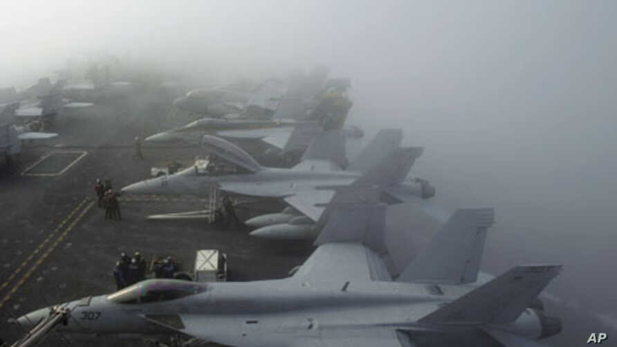 U.S. Navy F/A-18F Super Hornet fighter jets sit in heavy fog on the deck of the USS George Washington, during a joint military exercise off South Korea's West Sea. (File)