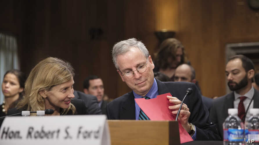 FILE - Robert Ford, U.S. ambassador to Syria, arrives to testify to the Senate Foreign Relations Committee about the conflict in Syria, on Capitol Hill in Washington.