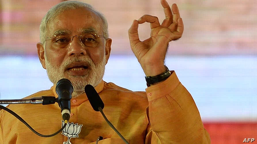Indian Prime Minister and Bharatiya Janata Party leader Narendra Modi gestures as he speaks during a public rally ahead of the  Maharashtra state election in Mumbai, Oct, 4, 2014.