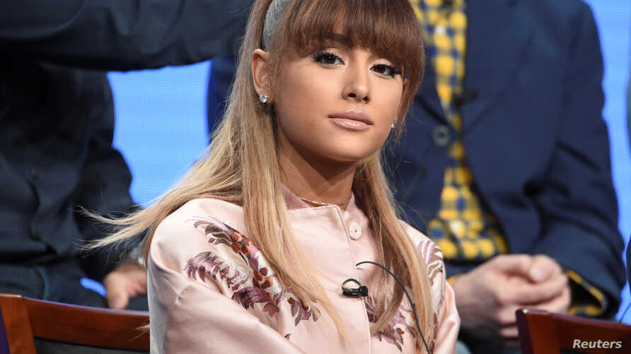 """FILE -  Ariana Grande answers questions during the panel for """"Hairspray Live!"""" at the NBC Universal Television Critics Association press tour in Beverly Hills, California."""
