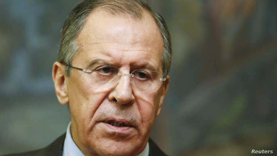Russian Foreign Minister Sergei Lavrov speaks during a news conference after a meeting with his Saudi Arabian counterpart, Saud al-Faisal, in Moscow, November 21, 2014.