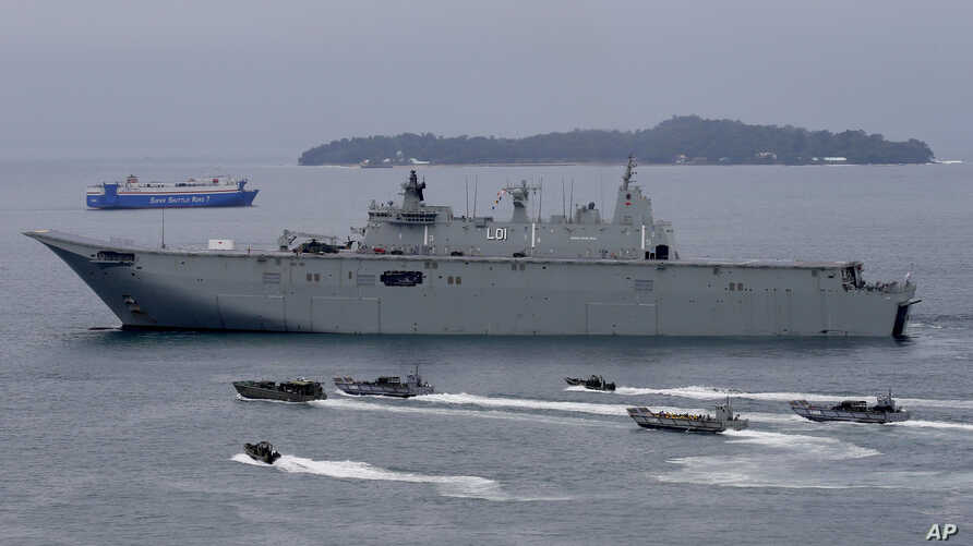 FILE -  the Royal Australian Navy HMAS Adelaide cruises alongside landing crafts with Philippine Marines and Australian troops as they conduct a joint Humanitarian Aid and Disaster Relief (HADR) exercise off Subic Bay in northwestern Philippines.