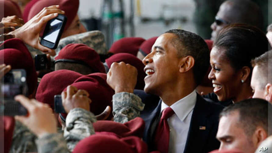 President Barack Obama and first lady Michelle Obama greet troops during a visit to Fort Bragg, N.C., Dec. 14, 2011.