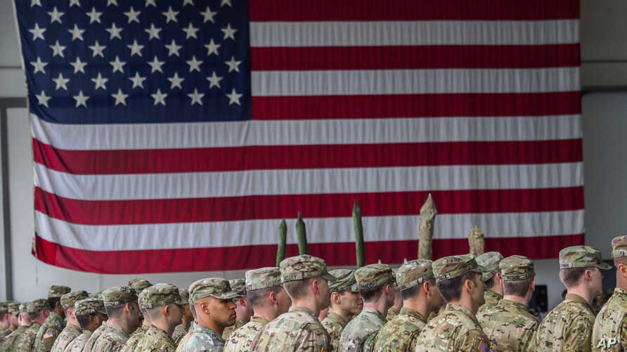 US soldiers stand in formation during a military ceremony in Illesheim, Germany, March 9, 2017. The Pentagon released base-by-base data Friday on sexual assault reports in ranks.