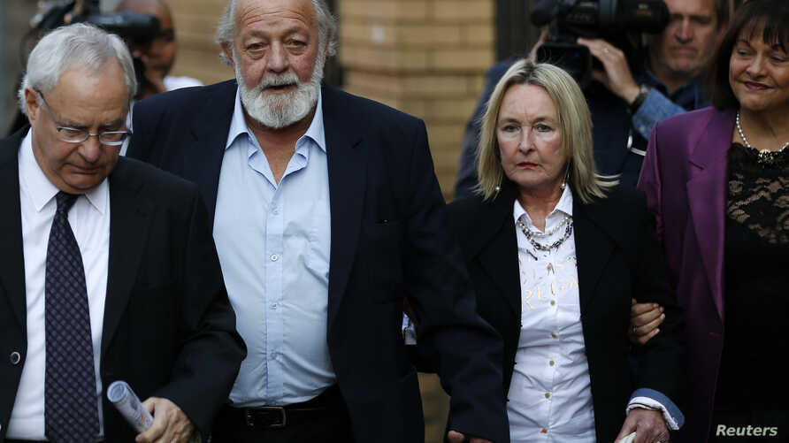 Reeva Steenkamp's parents, June (2nd R) and Barry Steenkamp (2nd L), arrive for the closing arguments of Paralympic track star Oscar Pistorius' murder trial at the high court in Pretoria August 7, 2014. Pistorius is accused of killing his girlfriend ...