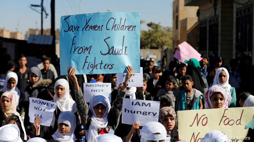 FILE - Children protest the Saudi-led coalition outside the U.N. offices in Sanaa, Yemen, Nov. 20, 2017.