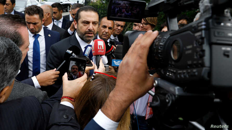 Lebanese Prime Minister-designate Saad al-Hariri speaks to the media in front of the Special Tribunal for Lebanon ahead of the closings arguments in the trial of Lebanon's Rafik al-Hariri alleged killers in the Hague, the Netherlands, Sept. 11, 2018.