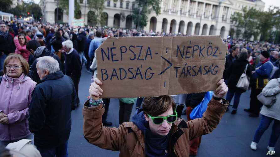 Demonstrators gather in front of  the Parliament building to show their solidarity with the Hungarian political daily Nepszabadsag in Budapest, Hungary, Saturday, Oct. 8, 2016.