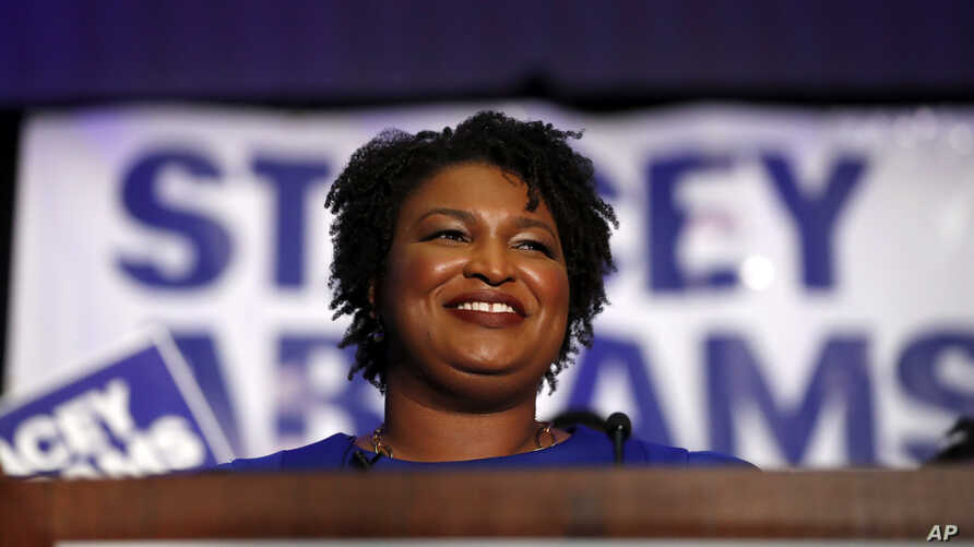 Democratic candidate for Georgia Governor Stacey Abrams smiles as she speaks during an election-night watch party, May 22, 2018, in Atlanta.