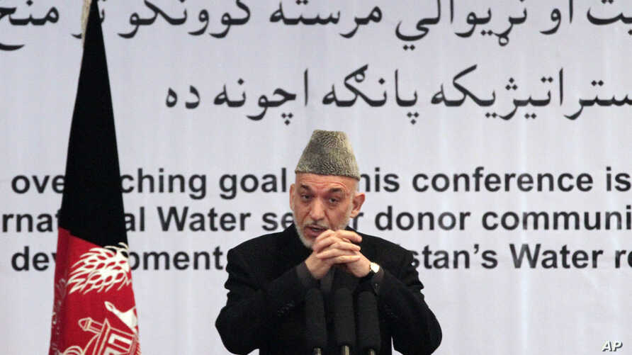 Afghan President Hamid Karzai gestures, as he speaks during a conference about water management in Kabul, Afghanistan, Tuesday, Jan. 29, 2013.