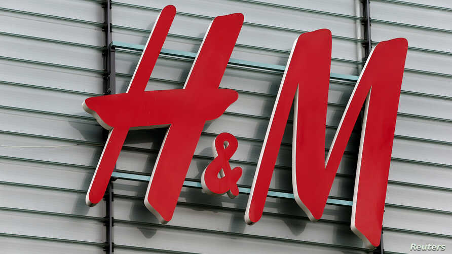 The logo of Swedish fashion retail group H&M is seen at a building in Dietlikon, Switzerland, Oct. 11, 2016.