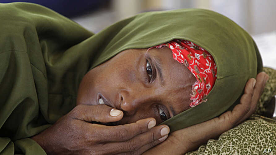 A malnourished woman lies in a field hospital of the International Rescue Committee, IRC, in the town of  Dadaab, Kenya, (File).