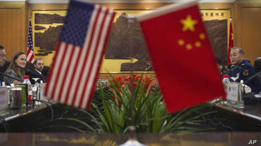 U.S. and Chinese officials during a bilateral meeting at the Bayi Building in Beijing, China, December 7, 2011.