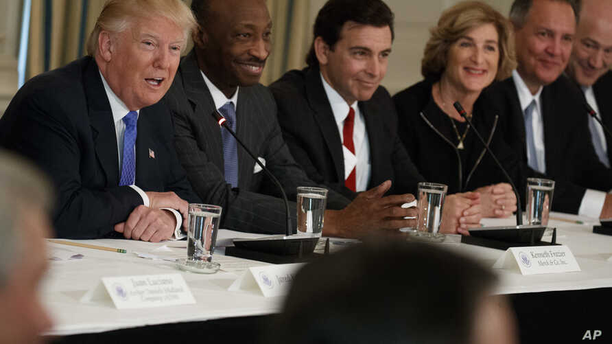 President Donald Trump, left, speaks during a meeting with manufacturing executives at the White House in Washington, Feb. 23, 2017.