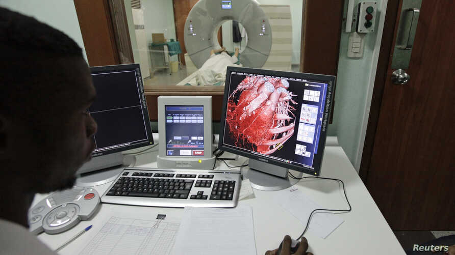 FILE - A doctor checks a screen showing a graphical representation of a human heart.