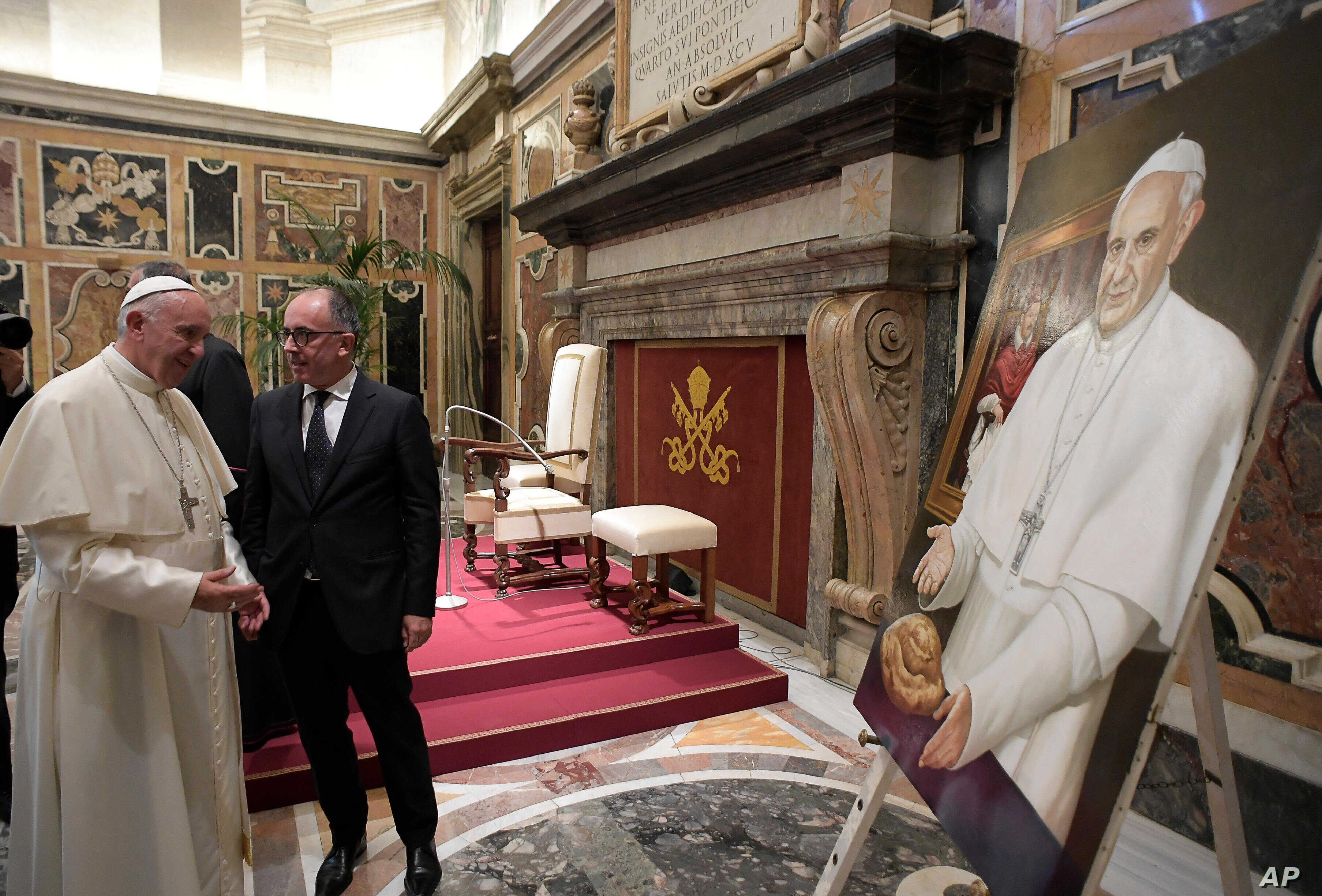 Vatican Pope Journalists: Pope Francis looks at a painting he received from the Italian Order of Journalists on the occasion of their audience, at the Vatican, Thursday, Sept. 22, 2016.